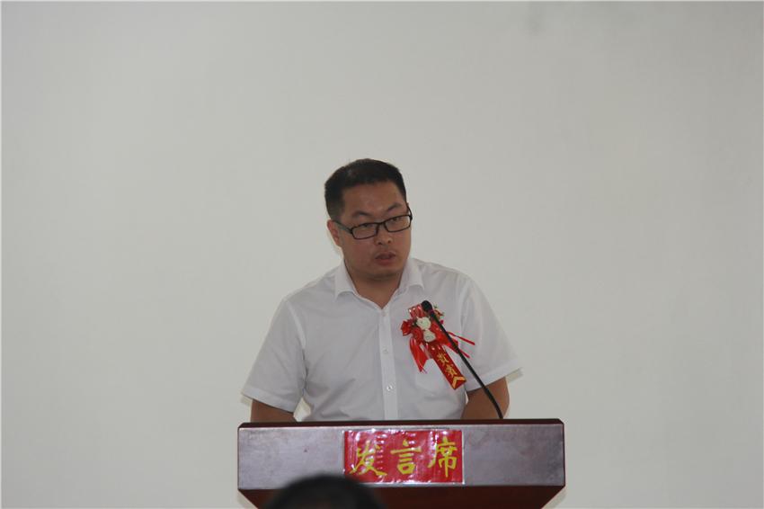 14百色市住房和城乡建设局物业科科长农本福发言.JPG